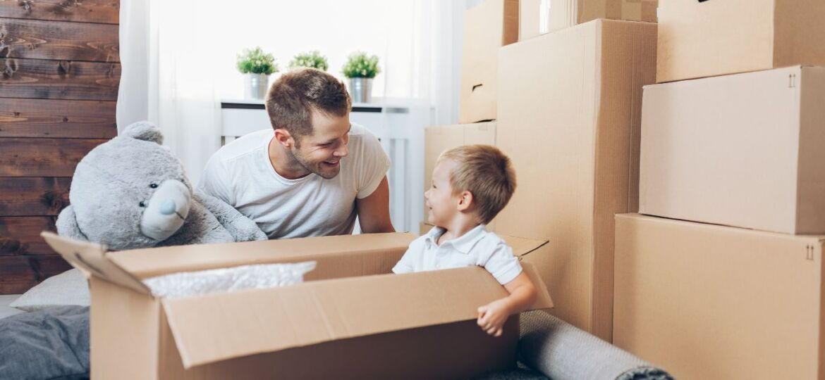 moving-concept-father-and-son-moving-to-a-new-QHJ348Z